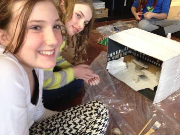 DVMS Upper Elementary students building dioramas to illustrate structural elements of novels.